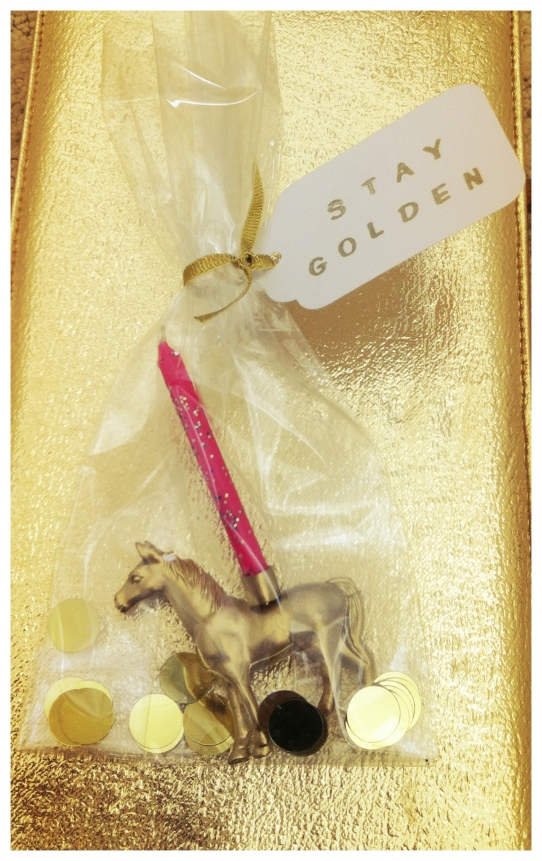 Party favor: Golden Stallion birthday candle holder!